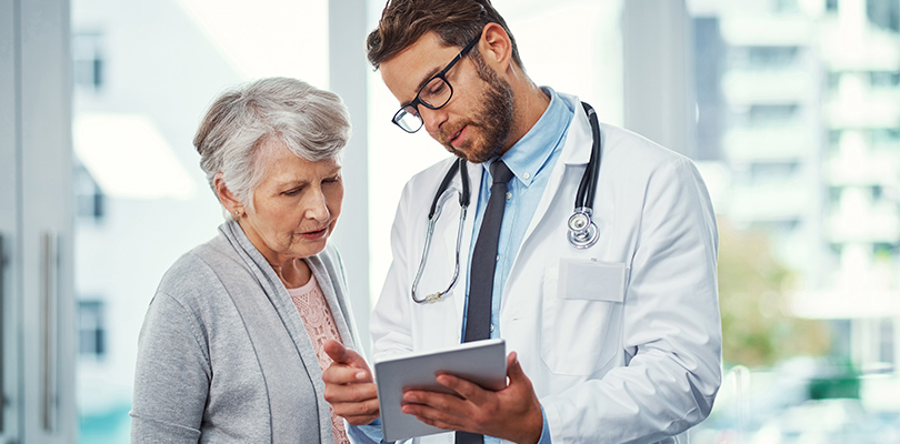 Older woman and her doctor looking at a chart